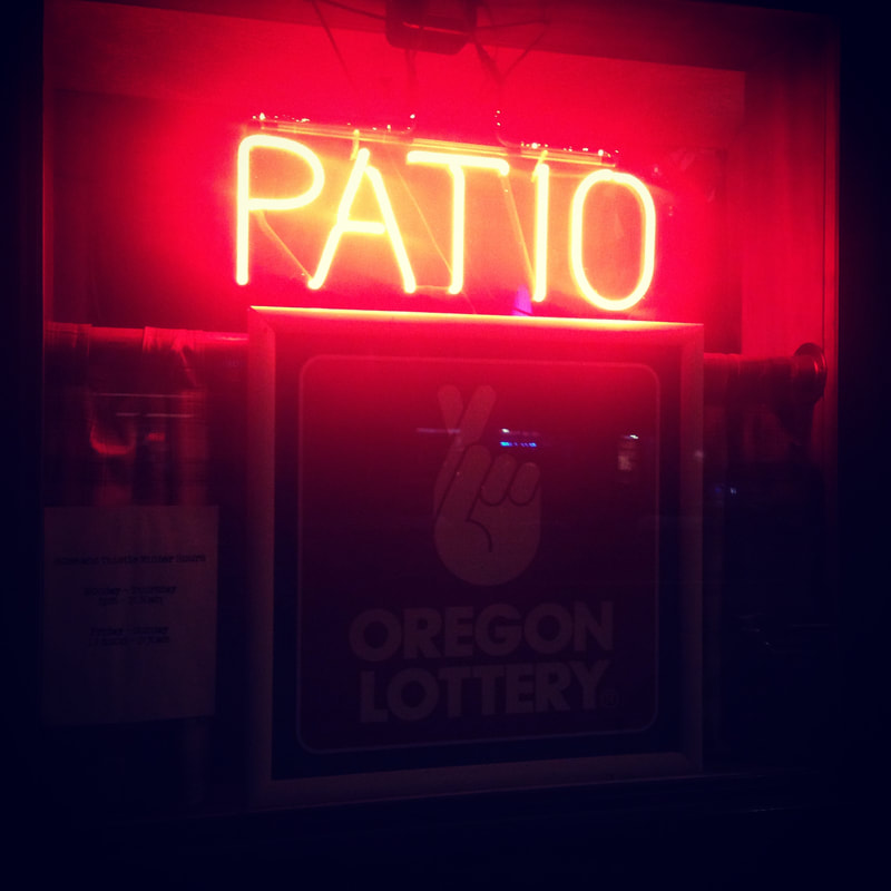 neon sign reading patio